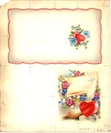 Heart inkwell with pierced parchment and flowers