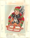Boy sledding with Cocker Spaniel