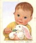 Baby feeding jellybean to bunny