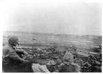 WWII Pacific Theater, combat photo: US airplane landing site and supply camp