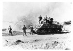 WWII Pacific Theater, combat photo: US Marines with flame-throwing tank