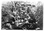 WWII Pacific Theater, combat photo: US Marines in make-shift camp by Earl F. Dickinson