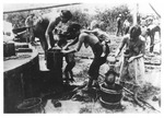 WWII Pacific Theater, combat photo: native women bathing children by Earl F. Dickinson
