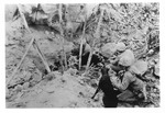 WWII Pacific Theater, combat photo: US Marines releasing dogs into tunnels