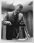 HPD Chief Gil Kleinknecht demonstrating new equipment, 1966