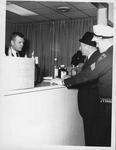 Chief Gil Kleinknecht and Sgt. Ottie Adkins inventory illegal alcohol seized during raid,