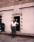 Unidentified man in front of Peytona Post office, Boone County, W.Va.
