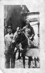 Grover Greer & E. G. Miller riding mule