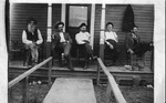 Dr. Oscar Hines & others on porch of Golden Rule Hall, East Lynn, 1910