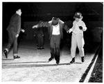 Young skaters Dena Thomas & Peter Calhoun, Memorial Field House, ca. 1950's