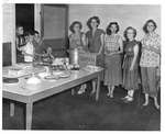 Ladies of Fetty serving children free lunch, Memorial Field House, ca. 1950's