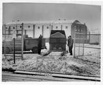 Dumping gravel for parking lot, Memorial Field House, Huntington,WVa, Jan 1958