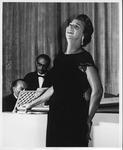 Jane Shepherd (Hobson) singing aboard ship, 1952