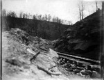 Railroad tracks through cut ca. 1900