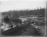 Railroad trestle and abutments under construction ca. 1900