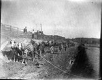 Railroad workers working on road bed, ca. 1900
