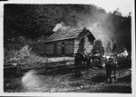 A typical pioneer log cabin by Huff