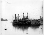 Steamboats docked at a wharf, probably on Ohio River, ca. 1890