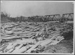 Log jam against C&O RR bridge, Guyandotte, W.Va.