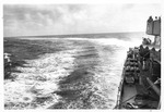 USS Trathen on hard turn during overboard drill, 1955