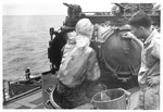 Torpedoman cleaning torpedo tubes after firing aboard USS Trathen, ca. 1955