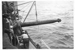 Recovery of dummy torpedo aboard USS Trathen, ca. 1955