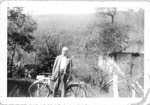 Uncle Cris Freeman, with Norma's bicycle, ca. 1940's