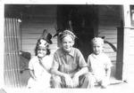 Mark Freeman (middle), sister Linda Freeman (left), unidentified, ca. 1940's