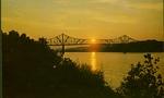 Sunset on the Ohio river, Huntington, W. Va. The bridge connects Huntington, W. Va. and Chesapeake, Ohio.