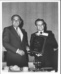 Marvin Stone receiving award from John Marvel, Pres. of AASCU
