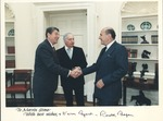 Pres. Ronald Reagan shaking hands with Marvin Stone