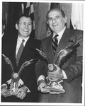 Marvin Stone and Donald Rumsfeld receiving the Eagle Award