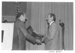 Marvin Stone presenting award to James Baker