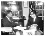 Pres. John F. Kennedy with Thomas L. Hughes, Asst. Sec. of State, Oct. 1961