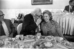 Matthew Reece sharing joke with Mrs. Cliff White at convention, Jan. 1975