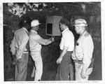 Instruction in testing for mine gas in coal mine, Bennett Ferguson, instr.ca. 1950's