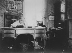 Clara Morrow at her desk, ca. 1910