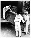 Myers Transfer movers unloading a truck, ca. 1956