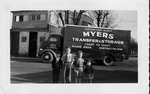 Photo of Myers moving truck, 4 boys in foreground