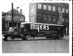 Myers Transfer van in front of Myers building, ca. 1950's