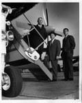 L. Roland Aberle (center) boarding plane at Tri-State Airport, Nov. 1966
