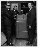Dr. Allen, George Mendenhall & Bob King unloading donated computer