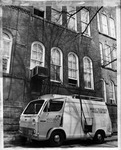 Mobile TV unit beside Old Main, ca. 1980