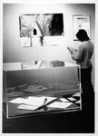 MU student Ellen Risch in Birke Art Gallery, Smith Hall