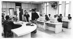 MU Journalism Prof. Ralph Turner (standing) and Teresa Minton in newsroom