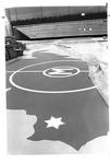 W.Va. and Marshall emblem in floor of Cam Henderson Center