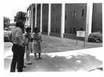People in front of Harris Hall, Marshall campus,