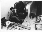 Bob Craft working on escalator in Smith Hall, ca. 1970's