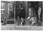 Workers in front of the Women's Gymnasium (Original Phys. Ed. Bldg), ca. 1980