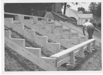 Building temporary bleachers outside of Women's Gymnasium